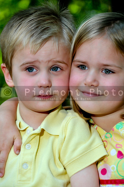 A happy little boy and girl brother and sister