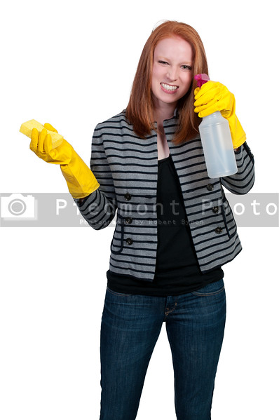 Aglove wearing beautiful woman or maid cleaning house with a sponge and spray bottle with cleaner