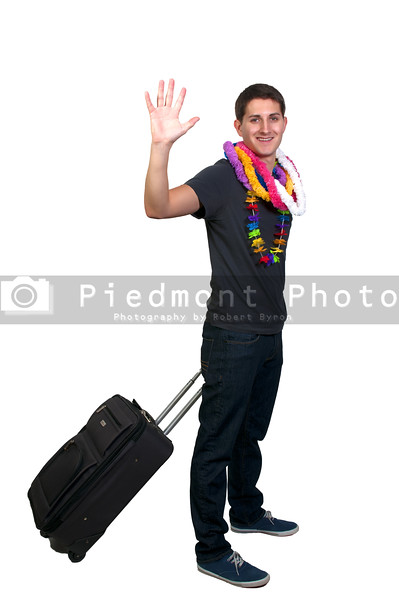 An attractive young man going on vacation