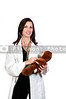 A woman doctor examining a stuffed animal patient.