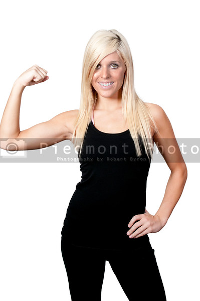 A beautiful young woman flexing her muscles