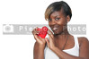 A beautiful young African American black woman holding a Valentines Day heart