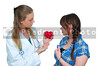 A female cardiologist doctor holding a red heart and talking to a patient