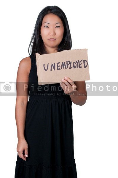 A beautiful young woman holding up a blank sign