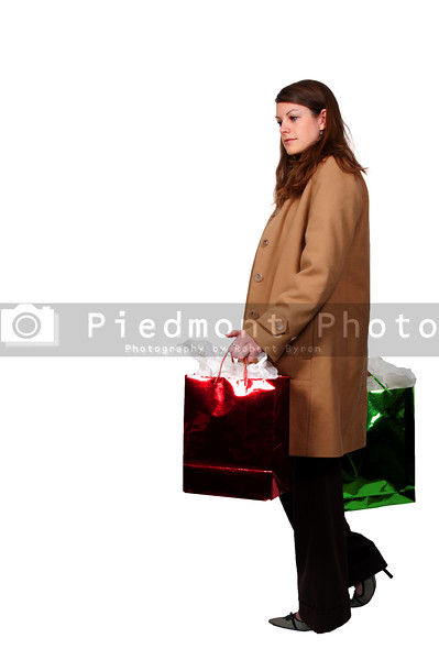 A beautiful young woman on a shopping spree holding shopping bags