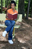 A young African American woman reading a book