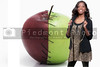 A black teenage girl standing next to a Stitched Apple