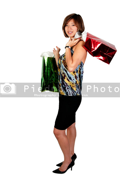 A beautiful young Asian woman on a shopping spree
