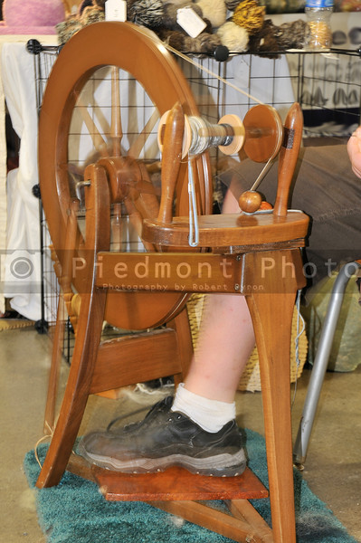 An spinning wheel used in the manufacture of yarn