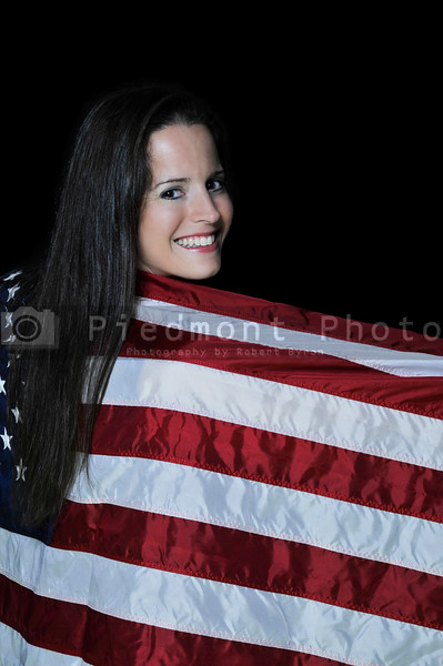 A beautiful young woman wrapped in a flag.