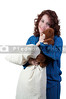A beautiful young woman wearing pajamas hugging her stuffed teddy bearand a pillow
