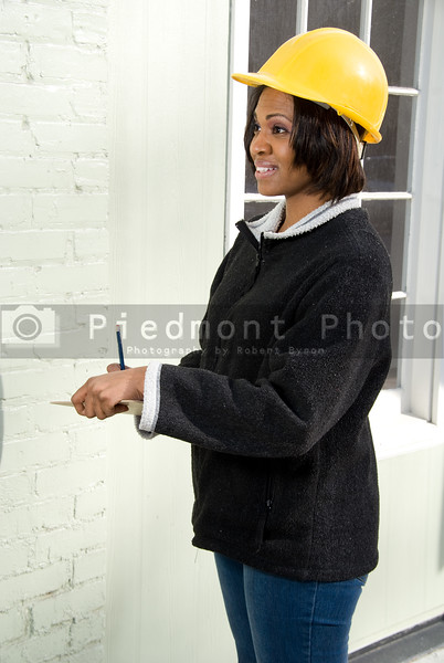 A female Construction Supervisor inspecting a building