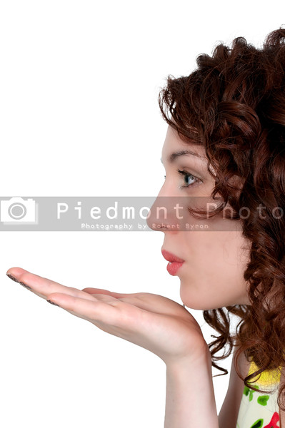 A beautiful young woman blowing a kiss