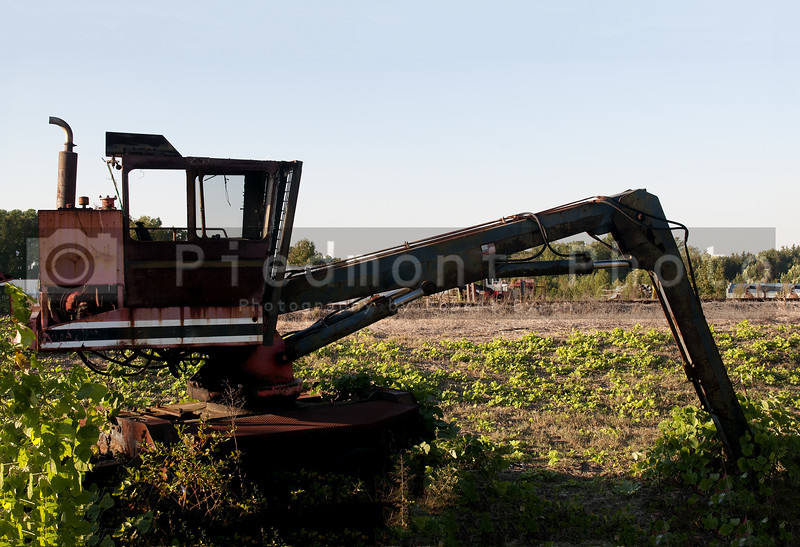 An old abandoned industrial excavator rusting away