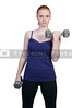 A beautiful young woman using weights during a workout