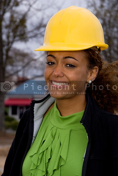 A beautiful young female construction supervisor on a job site