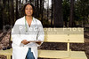 A female African American doctor sitting on a bench