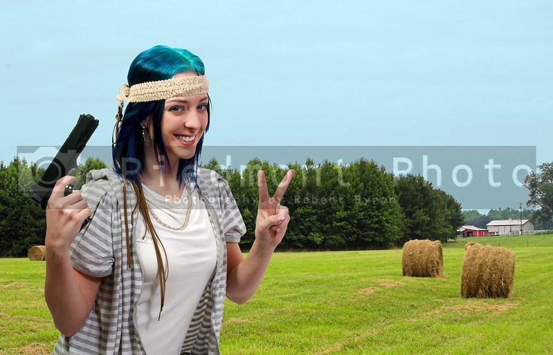 A crazy hippy woman holding a handgun