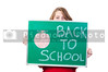A beautiful teenaged girl holding a back to school sign