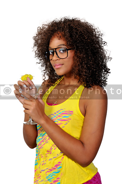 A beautiful African American woman holding wine glasses