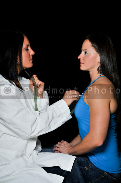A beautiful young female doctor examaning a beautiful woman