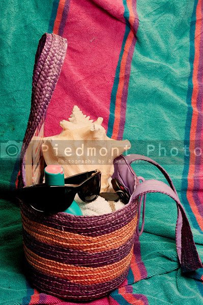 Various items in a basket ready for the beach