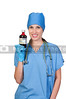 A woman doctor holding a bottle of prescription medication
