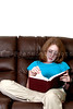 A beautiful young teenager reading a book