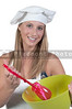 A beautiful young woman chef holding a salad bowl and tongs