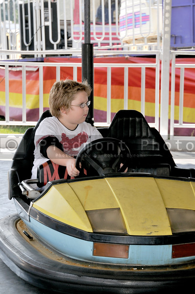 A young boy driving a bumper car