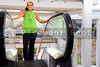 A beautiful young woman on an esclator at a shopping center
