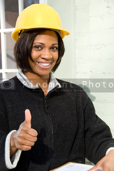 A female Construction Supervisor approving a building
