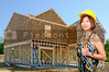 A beautiful Asian Female Construction Worker on a job site.