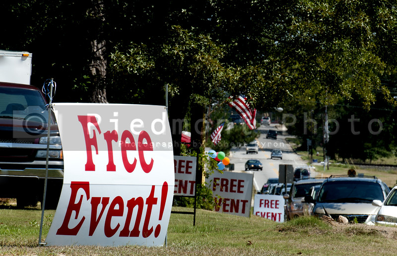 A series of signs advertising a free event
