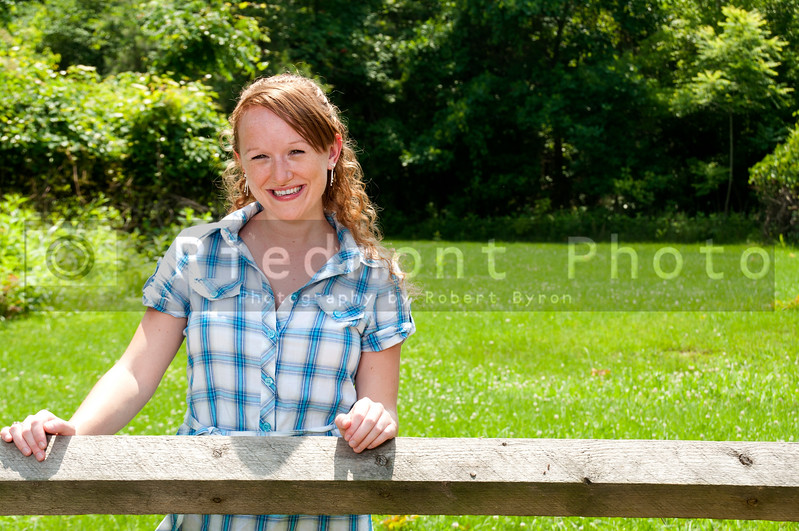 A beautiful country girl standing in a rural setting