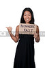 A beautiful young Asian woman holding up a sign that says Nowhere Fast