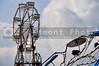 A large ferris wheel or big wheel at a fair.