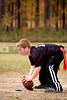 A young boy hiking a football during a game