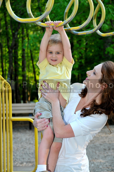 A mon playing with her son at a park