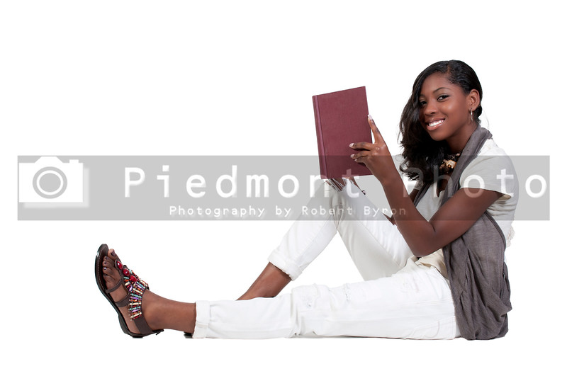 A young African American teenage woman reading a book