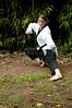 A young teenage girl practicing her Karate moves