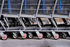 A long line of retail shopping carts