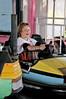 A young boy driving a bumper car