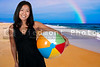 A beautiful young Asian woman holding a beachball