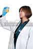 A beautiful young Asian woman doctor holding a urine sample