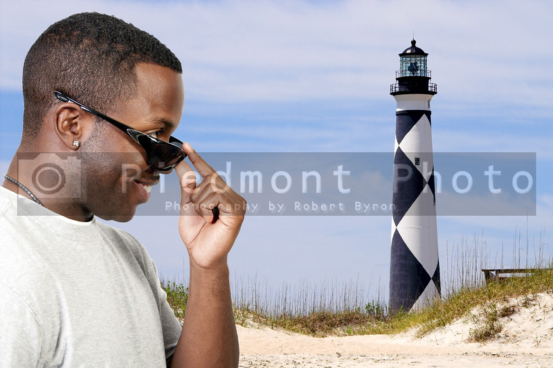 A black african american man wearing a pair of sun glasses