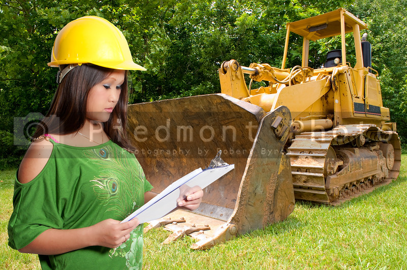 A Hispanic Woman Construction Worker on a job site.