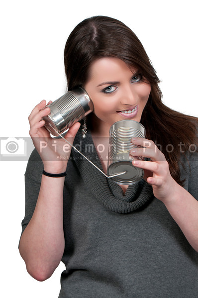 A woman talikng on a primative phone