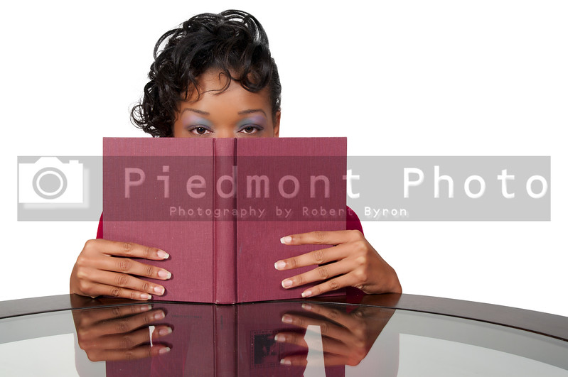 A young African American black woman reading a book