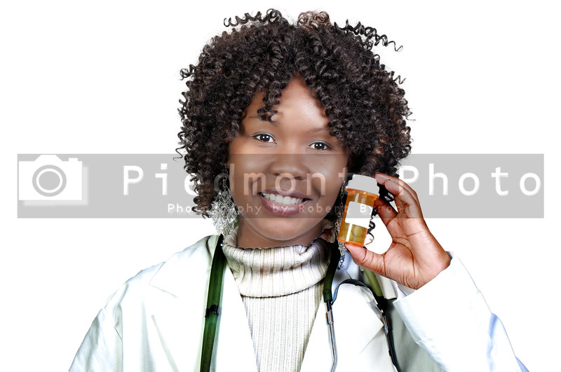 An doctor holding a bottle of prescription medication